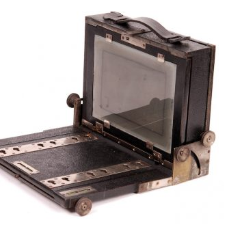 Rare leather covered folding tailboard camera by ANTOINE