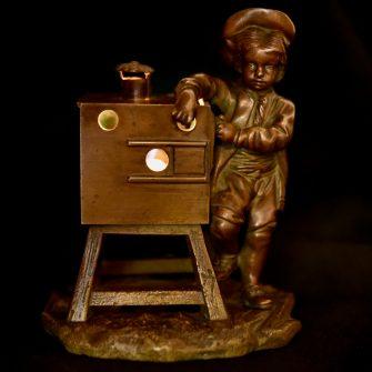 Veilleuse en bronze boite optique à l'enfant